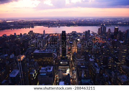 Panoramic view from the Empire State building on skyscrapers of the New York City on sunset - stock photo