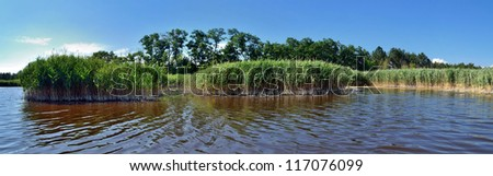 panoramic view from water to land on a salt lake in steppe part of Kherson region in Southern Ukraine - stock photo