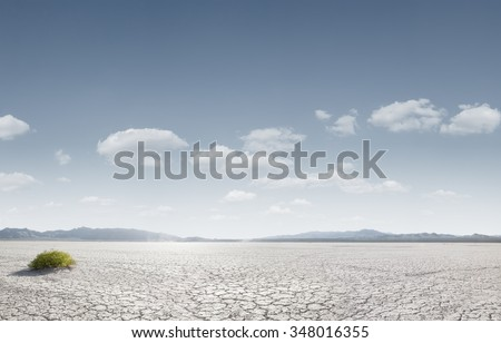 panoramic view od dry desert in death valley with some mountains on the back  - stock photo