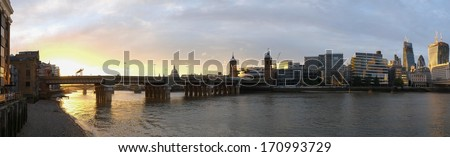 Panoramic view of a bridge and modern building in London on sunset - stock photo