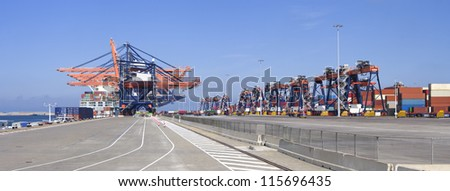 panoramic view of a container terminal in the Rotterdam harbor - stock photo