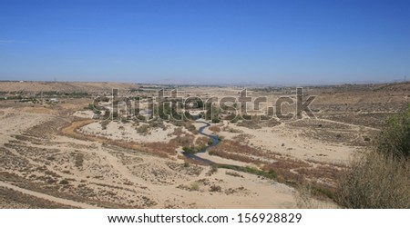 Panoramic view of a creek running through the high desert, California - stock photo