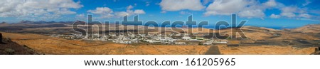 Panoramic view of a fishing village in Lanzarote, Canary Islands - stock photo