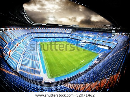 panoramic view of a football stadium with dramatic feel - stock photo