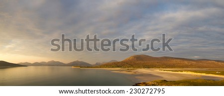 Panoramic view of a lagune of the coastal beach of Harris (Outer Hebrides) Scotland) at sunset - stock photo