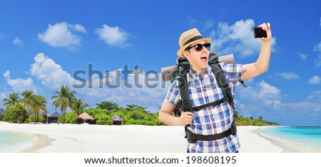 Panoramic view of a Male tourist taking selfie at a beach at Maldives Islands - stock photo