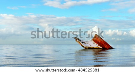 Panoramic view of a ship wreck rusty landscape sinking into the sea Trinidad and Tobago
