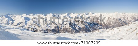 Panoramic view of a snow covered mountain range - stock photo