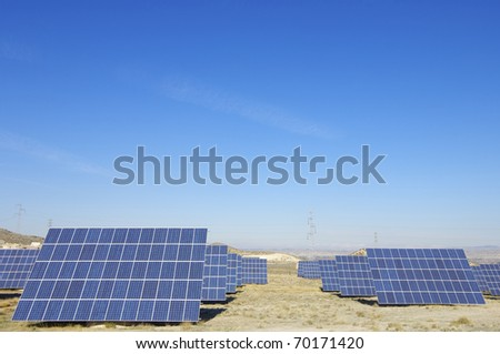 Panoramic view of a solar field to power production - stock photo