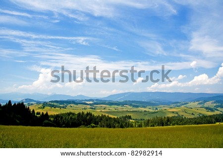 Panoramic view of a summer hilly countryside in Slovakia, Europe. - stock photo