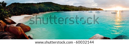 Panoramic view of a tropical beach at dawn. Anse Lazio, Praslin island, Seychelles, Indian Ocean. - stock photo