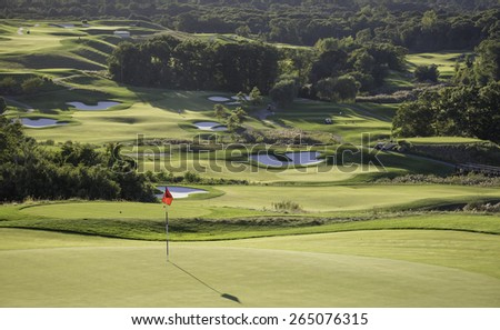 Panoramic view of a very well groomed golf course in the high season. - stock photo