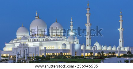 Panoramic view of Abu Dhabi Sheikh Zayed Mosque by night, UAE - stock photo