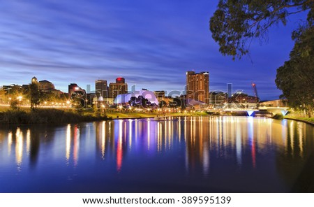 panoramic view of Adelaide's CBD reflecting in still torrens river waters with bright lights and illumination