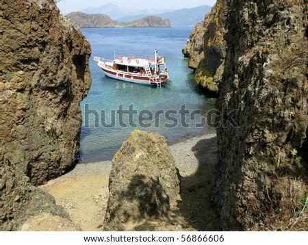 panoramic view of aegean islands among rocks - stock photo