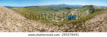 Panoramic view of amazing valley with lake in the spring mountains - Svydovets range, Carpathians, West Ukraine - stock photo
