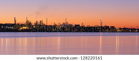 Panoramic view of an oil refinery  - stock photo