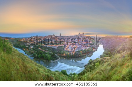 Panoramic view of ancient city and Alcazar on a hill over the Tagus River, Castilla la Mancha, Toledo, Spain - stock photo
