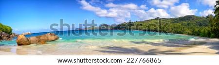 Panoramic view of Anse Takamaka beach with typical granite rocks, Mahe, Seychelles - stock photo