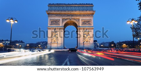 Panoramic view of Arc de Triomphe by night, France - stock photo