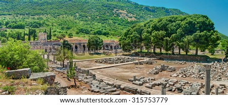panoramic view of archeological excavations site at Ephesus with fragments of columns at foreground and Celsus Library at backgroundon sunny day, Turkey - stock photo
