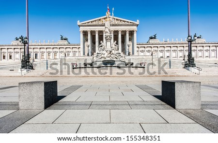 Panoramic view of Austrian parliament building with famous Pallas Athena fountain and main entrance in Vienna, Austria - stock photo