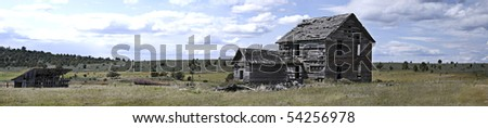 "Panoramic view of back of 19th century homestead house with horse barn and windmill.  Measures 55.296"" x 12.05"" - stock photo"