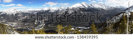 Panoramic view of Banff town site and surrounding mountains, as seen from Sulphur Mountain, Banff National Park, Canada - stock photo