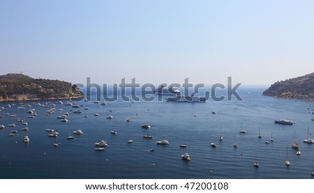 Panoramic view of bay near city of Nice. Many sail boats, cruise ships.