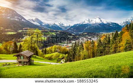 Panoramic view of beautiful mountain landscape in the Bavarian Alps with village of Berchtesgaden and Watzmann massif in the background at sunrise, Nationalpark Berchtesgadener Land, Bavaria, Germany - stock photo