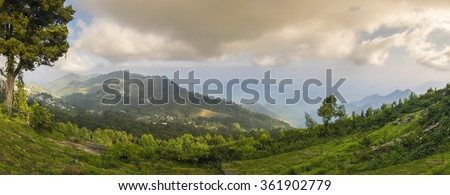Panoramic view of beautiful Palani hills seen from Coaker's walk located on the southern slopes of the beautiful hill station of Kodaikanal, India - stock photo