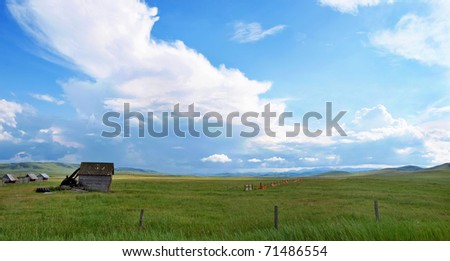 Panoramic view of beautiful prairie landscape with old barn and blue sky and clouds in Alberta, Canada - stock photo