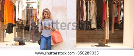 Panoramic view of beautiful teenager woman in city shopping street by fashion store, smiling using a smartphone to network online, outdoors. Adolescent consumer using technology, lifestyle exterior. - stock photo