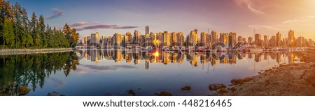 Panoramic view of beautiful Vancouver skyline and famous harbor area from stanley park in idyllic evening light at sunset in summer, British Columbia, Canada - stock photo