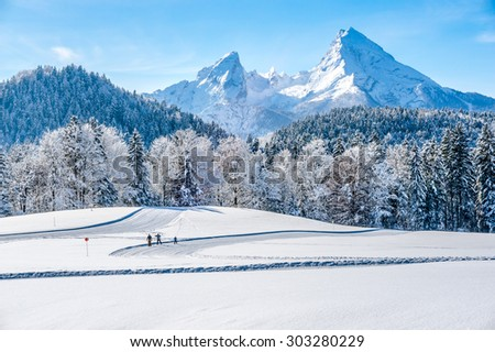 Panoramic view of beautiful winter landscape in the Bavarian Alps with cross-country slopes and famous Watzmann massif in the background, Nationalpark Berchtesgadener Land, Bavaria, Germany - stock photo
