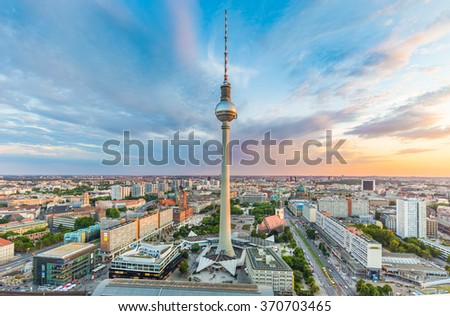 Panoramic view of Berlin skyline with famous TV tower at Alexanderplatz and dramatic cloudscape in beautiful evening light at sunset, Germany - stock photo
