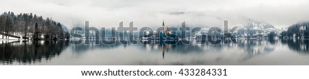 Panoramic view of Bled lake in the morning, Slovenia. Fog over the city. Famous church in the mountains - stock photo