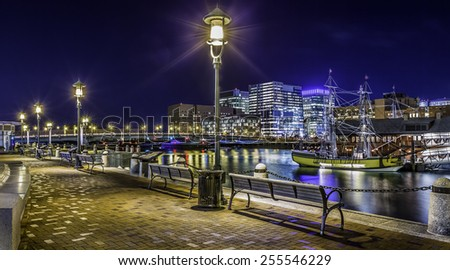 Panoramic view of Boston in Massachusetts, USA at night showcasing the architecture of its Financial District at Back Bay. - stock photo
