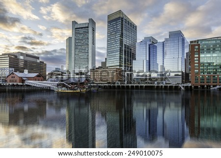Panoramic view of Boston in Massachusetts, USA showcasing the architecture of its Financial District at sunset. - stock photo