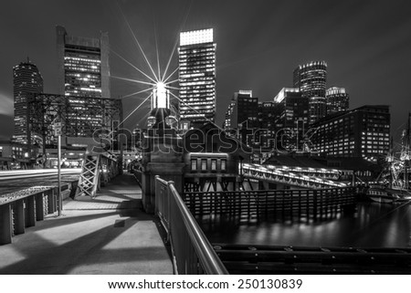 Panoramic view of Boston in Massachusetts, USA showcasing the architecture of its Financial District at Night. - stock photo