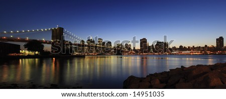 Panoramic view of Brooklyn Bridge and Manhattan skyline at dusk - New York City, USA (high-res panoramic shot stitched from 5 pictures)