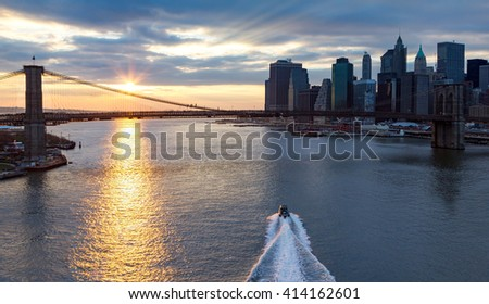 Panoramic view of Brooklyn Bridge and Manhattan Skyline at sunset in New York City - stock photo