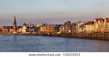 Panoramic view of building facades of Dusseldorf embankment at the sunset, Germany - stock photo