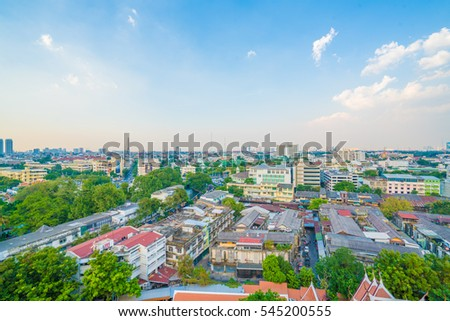 Panoramic view of buildings of Bangkok and part of Wat Saket from top of Golden Mount