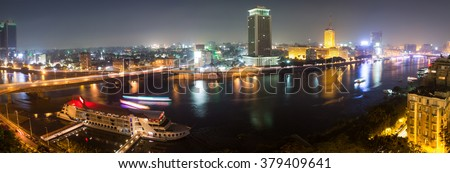 Panoramic view of Cairo from the island of Zamalek, the Nile river, the Corniche and the city. - stock photo