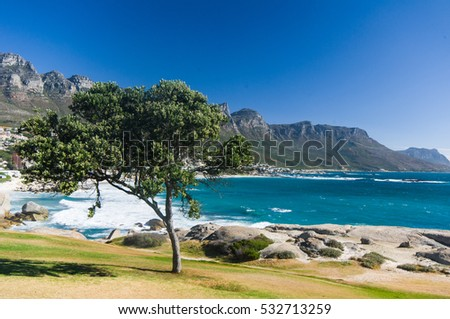 Panoramic view of Camps Bay beach with the view of the Twelve Apostles mountain range.Cape Town.South Africa