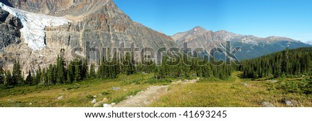 Panoramic view of canadian rocky mountains and meadows from the hiking trail beside mountain edith cavell, jasper national park, alberta - stock photo