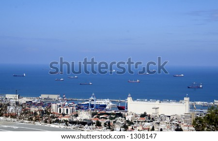 panoramic view of cargo ships in Haifa's Harbor israel. - stock photo