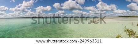 Panoramic view of caribbean lagoon Bacalar. Seven Color water. Pier and Hut. - stock photo