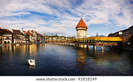 Panoramic view of Chapel Bridge, famous covered wooden bridge, and swan. Lucerne Switzerland. - stock photo